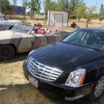 classic 1969 Cadillac Convertible DeVille next to a late model black cadillac